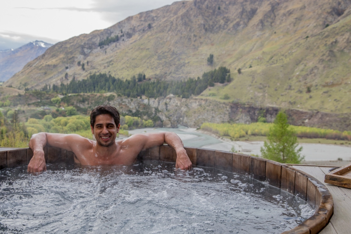 Sidharth enjoying his time in a hot pool in Queenstown